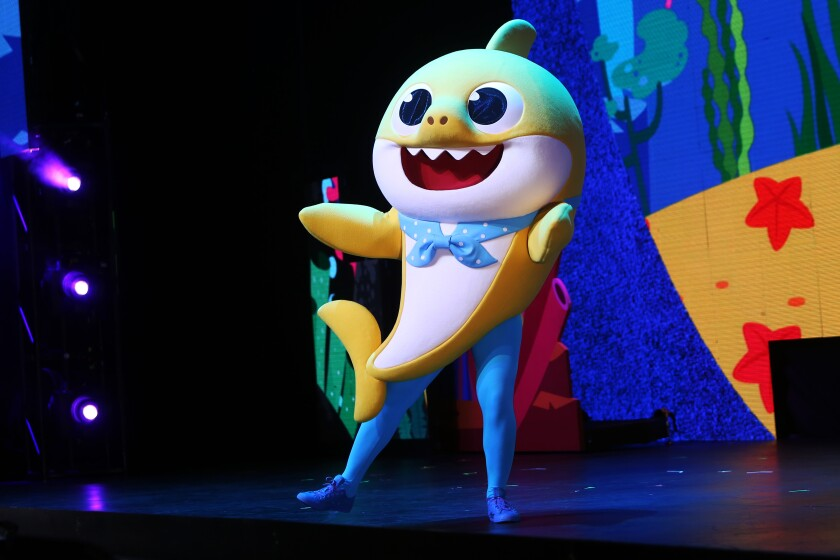 Baby Shark dances on stage during a Baby Shark Live! performance in October at the Terrace Theater in Long Beach.