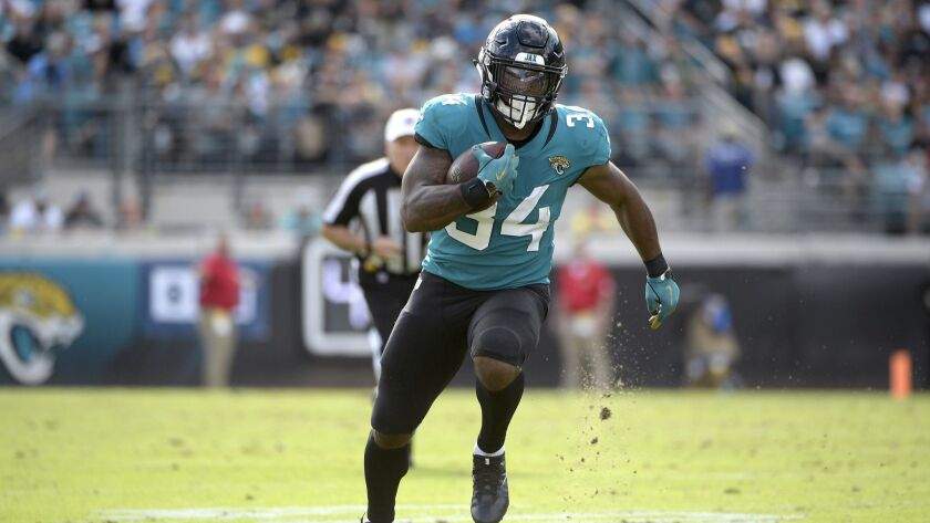 Jacksonville Jaguars running back Carlos Hyde (34) rushes for yardage during the first half of an NF