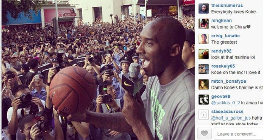 Kobe Bryant greets fans in Shenzhen, China.