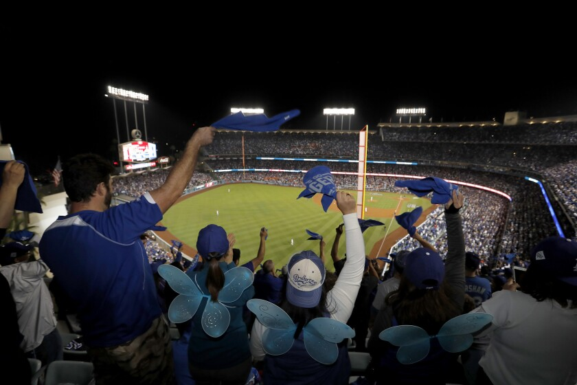 Fans celebrate as the Dodgers beat the Astros 3-1 in Game 6 of the World Series on Oct. 31 at Dodger Stadium.