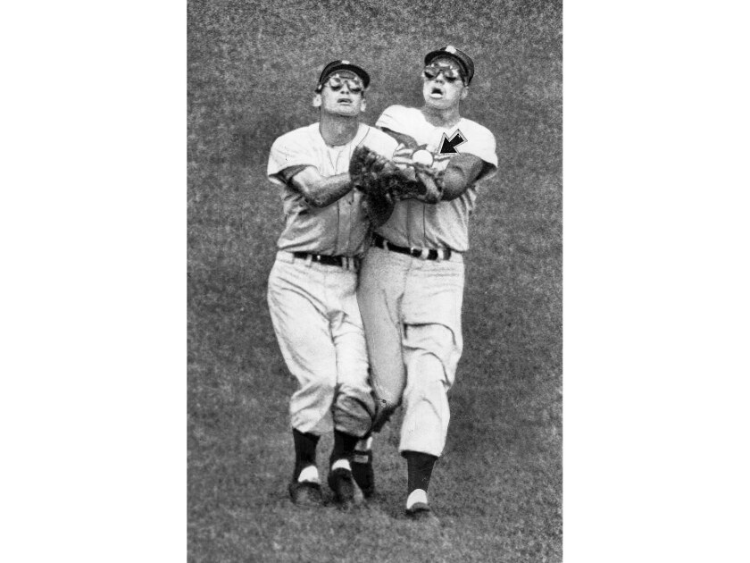 Oct. 1, 1959: Ball pops out of glove of Dodger center fielder Duke Snider, right, as he and left fielder Wally Moon collide in the third inning of opening game in 1959 World Series. They were trying to catch White Sox's Sherm Lollar fly ball. The White Sox won the first game 11-0.