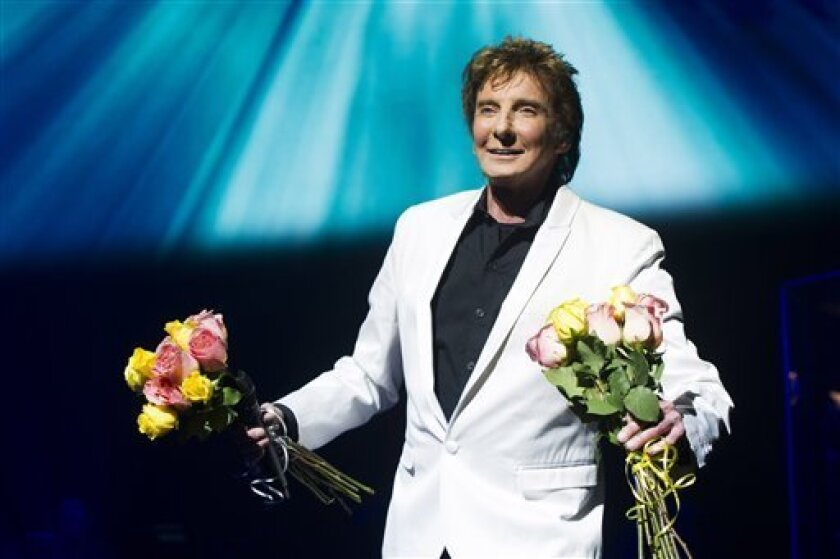 """FILE - This Jan. 29, 2013 file photo shows Barry Manilow at the opening night curtain call for""""Manilow on Broadway"""" in New York. The Man Who Makes the Whole World Sing is used to far bigger venues than the 1,710-seat St. James Theatre, one of the smaller theaters on the Great White Way. (Photo by C"""