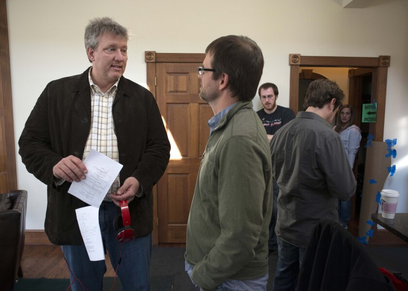 """In this photo provided by Point Park University, producer Chris Moore, left, talks with Point Park University Cinema Arts Associate Professor Nelson Chipman, on the set of Anna Martemucci's film, """"Hollidaysburg,""""in Carnegie, Pa. on March 15, 2014. Television network Starz debuts a TV reality series """"The Chair"""" on Sept. 6, 2014. The series documents the production of two separate movies using the same script. """"Hollidaysburg"""" is Martemucci's version, and the other version directed by Shane Dawson, is called """"Not Cool."""" Those two Pittsburgh-shot movies will then subsequently have theatrical and digital releases. """"The Chair"""" will air in one-hour installments each Saturday through mid-November. (AP Photo/Point Park University)"""