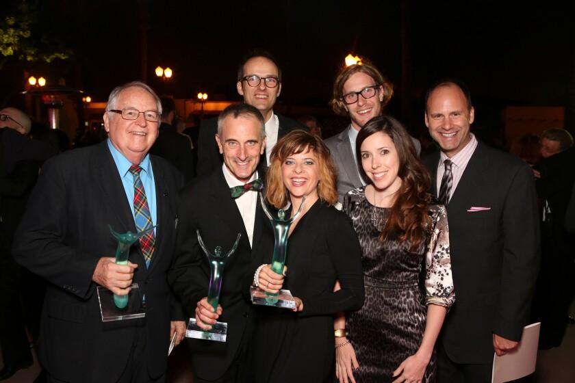 At the Ovation Awards, from left, Dakin Matthews, Neel Keller, Adrian W. Jones, Jennifer Haley, Adam Haas Hunter, Lindsay Allbaugh and Pier Carlo Talenti.