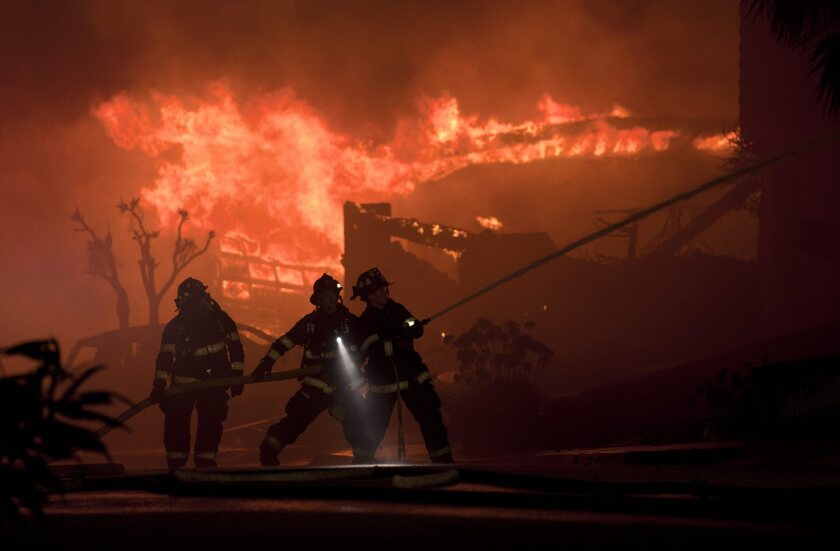 Firefighters battle house fires after a massive explosion rocked a neighborhood in San Bruno in 2010.
