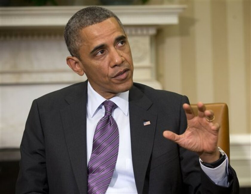 President Barack Obama answers a question regarding the ongoing situation in Syria during his meeting with Jordan's King Abdullah II, in the Oval Office of the White House in Washington, Friday, April 26, 2013. (AP Photo/Pablo Martinez Monsivais)