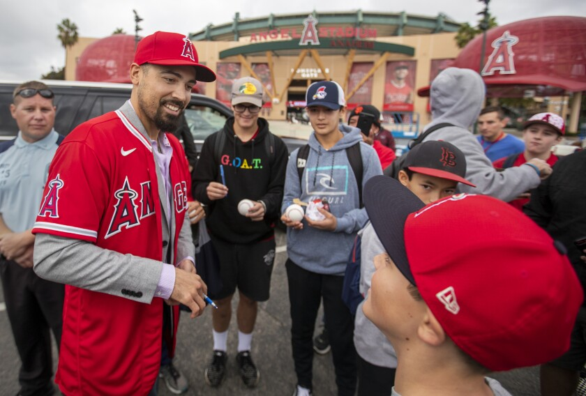 New Angels third baseman Anthony Rendon signs autographs and takes photos with fans after a news conference Dec. 14, 2019, at Angel Stadium.