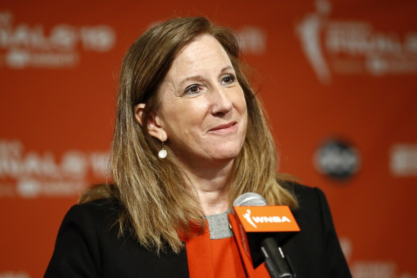 """FILE - In this Sept. 29, 2019, file photo, WNBA Commissioner Cathy Engelbert speaks at a news conference in Washington. WNBA rookies will start receiving health benefits beginning Friday, May 1, 2020. """"Given the unique nature of this crisis, rookies and other new players currently under contract will receive full health benefits beginning on May 1, while veterans, who already receive year-round health benefits, will not have any break in their coverage,"""" WNBA Commissioner Engelbert told The Associated Press. (AP Photo/Patrick Semansky, File)"""