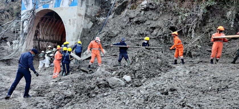 This photograph provided by National Disaster Response Force shows NDRF personnel prepare to rescue workers at one of the hydropower project at Reni village in Chamoli district of Indian state of Uttrakhund, Monday, Feb. 8, 2021. Rescue efforts continued on Monday to save 37 people after part of a glacier broke off, releasing a torrent of water and debris that slammed into two hydroelectric plants on Sunday. (National Disaster Response Force via AP)