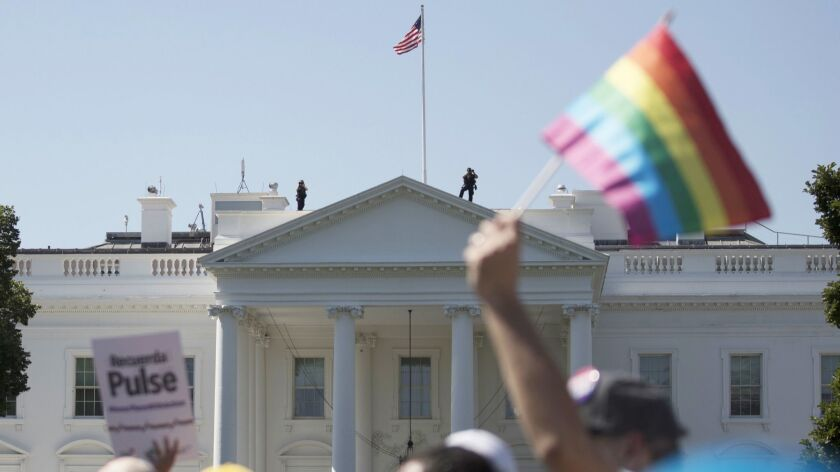 Equality March for Unity and Pride participants march past the White House in Washington on June 11, 2017.
