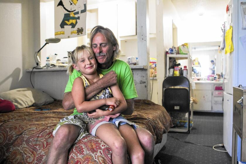 Mike Jensen and his daughter Hallee live in a small room at the Costa Mesa Motor Inn with Jensen's wife and their two other children. The family's monthly rate at the Motor Inn is hundreds of dollars less than the typical rent for a one-bedroom apartment in Costa Mesa.