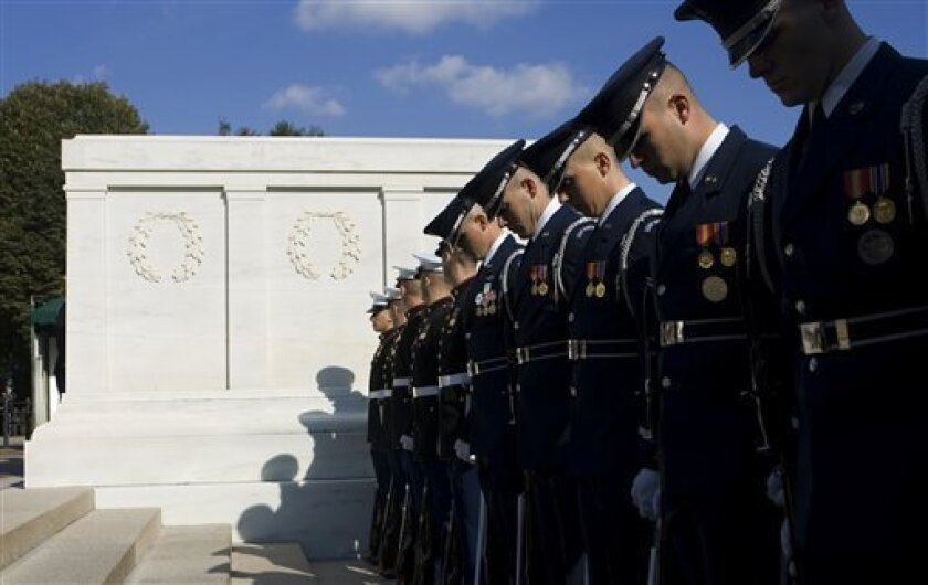 FILE - In this Nov. 11, 20007 file photo, honor guard members stand in formation beside the Tomb of the Unknowns in Arlington National Cemetery in Arlington, Va. (AP Photo/Manuel Balce Ceneta, File)