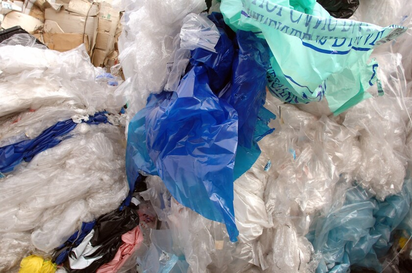 California's proposed ban on single-use plastic bags would apply to supermarkets and large grocery stores starting July 1, 2015. Above, used plastic bags in a recycling container in France.