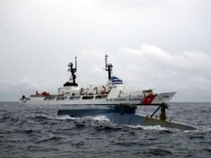 U.S. Coast Guard Cutter interdicts a 35-ft self-propelled semi-submersible carrying cocaine.  Photo/Monica leftwich