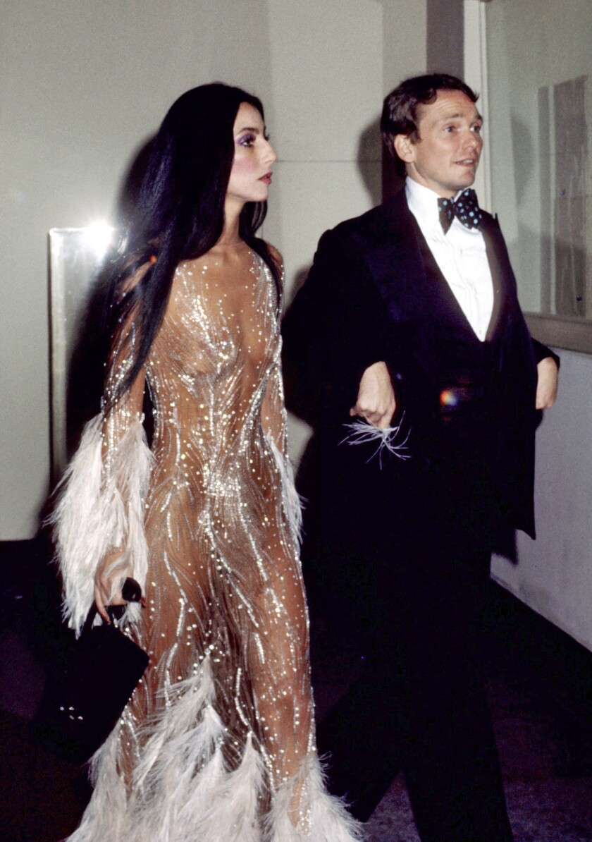 Bob Mackie and Cher at The Met Ball (1974).