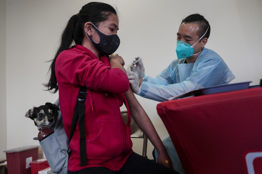 A woman gets a vaccine