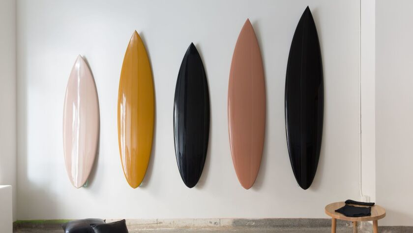 Designer Heidi Merrick's brother, Britt, created surfboards ($1,850 each) that mimic a shape originally designed for pro surfer Dane Reynolds. The boards are also available at H. Merrick of California.