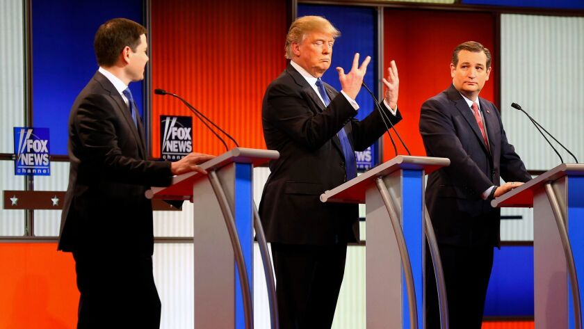 Then-presidential candidate Donald Trump gestures as Sen. Marco Rubio, R-Fla. (left) and Sen. Ted Cruz, R-Texas (right) watch him at a Republican presidential primary debate in Detroit on March 3, 2016.