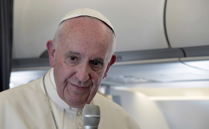 Pope Francis addresses journalists during the traditional press conference on his flight back to Rome on May 13, 2017.