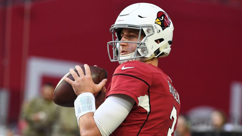 Josh Rosen of the Arizona Cardinals warms up for before a game against the Oakland Raiders.