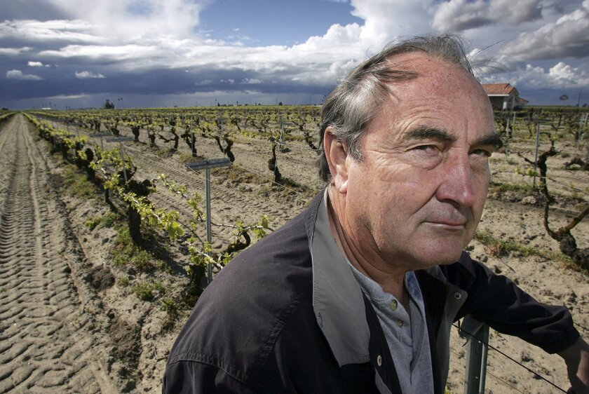 California raisin farmer Marvin Horne stands in a field of grapevines planted in 1918 next to his home in Kerman.