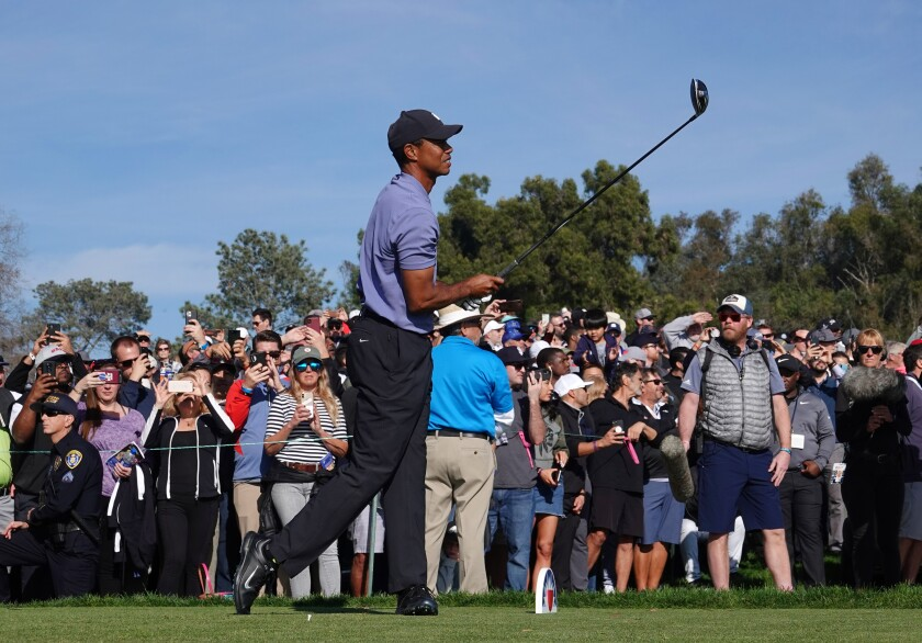 Tiger Woods tees off on his 18th hole on the Torrey Pines North Course during the first round of the Farmers Insurance Open.