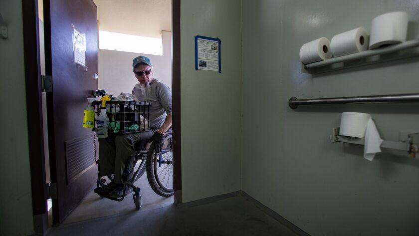 JOSHUA TREE, CA - JANUARY 8, 2019: Wheelchair bound Rand Abbott,55, of Joshua Tree prepares to clean