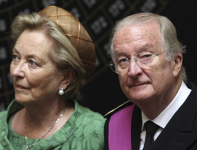 Queen Paola and King Albert II of Belgium are reportedly struggling to adjust to their $1.2-million annual pension after giving up the $15.4-million yearly stipend for reigning royals when he abdicated in July. The couple are shown here at the July 21 ceremonial transfer of power to son Philippe.