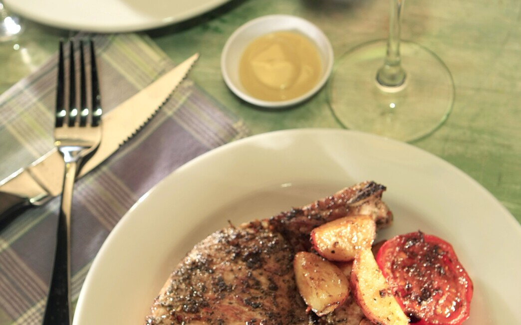 Herbed pork chops with tomatoes, potatoes and spinach