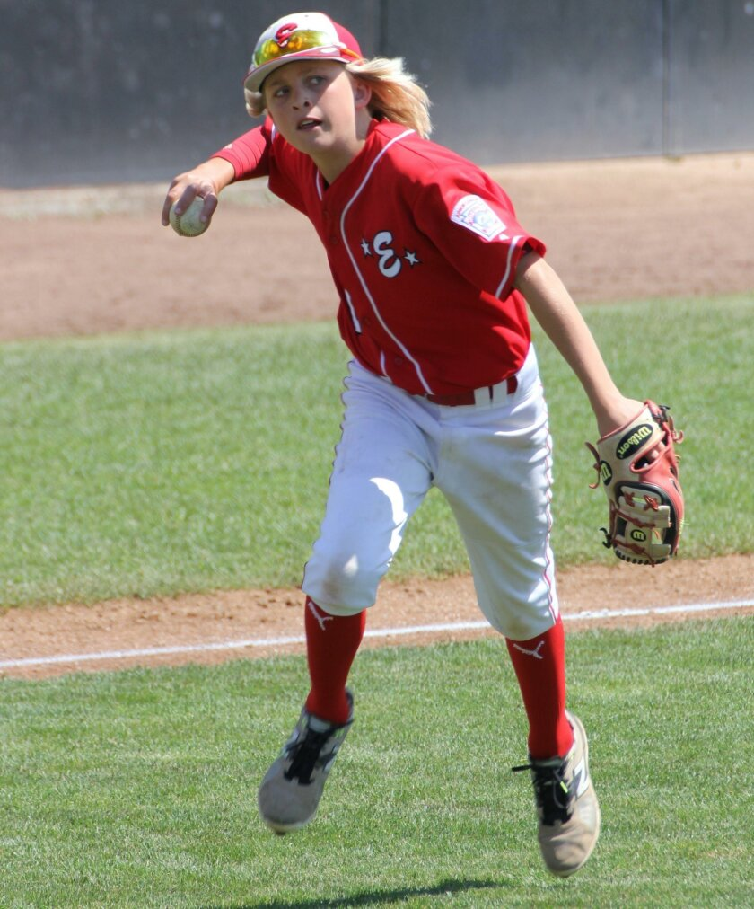Encinitas Juniors third baseman Cooper Dulich gets set to throw out a runner during the West Regional tournament earlier this month in Vancouver, Wash. ELL fell just short of qualifying for the Little League World Series.