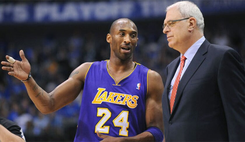 Kobe Bryant speaks to then-Lakers coach Phil Jackson during the 2011 playoffs.