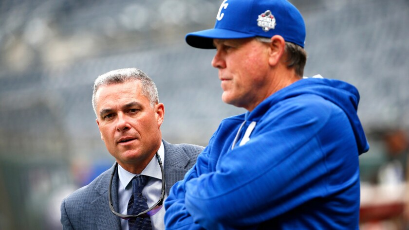 Dayton Moore, left, helped build the Kansas City Royals into a winner for Manager Ned Yost.