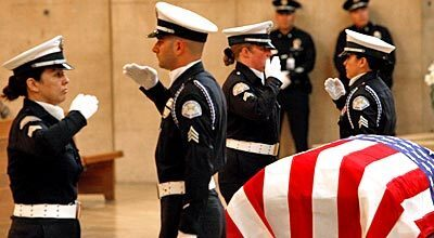 LAPD Honor Guard members salute during the service for former LAPD Chief Daryl Gates.