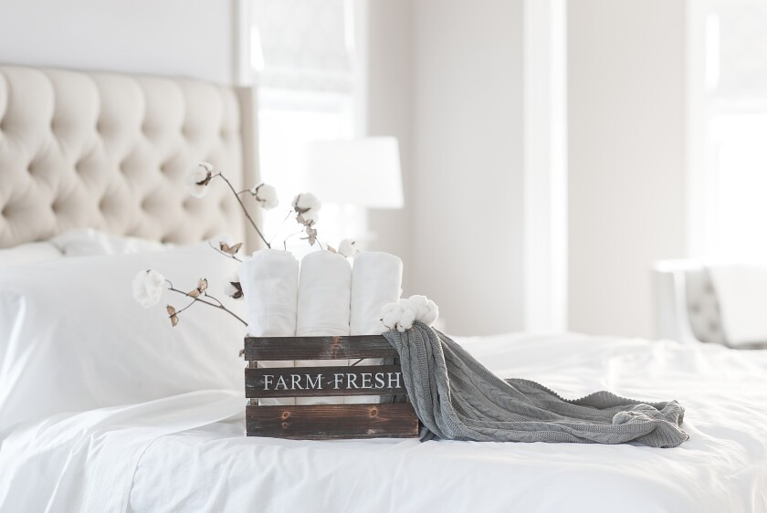 Boll & Branch produces sheets and cable-knit throws made exclusively from Global Organic Textile Standard-certified cotton.