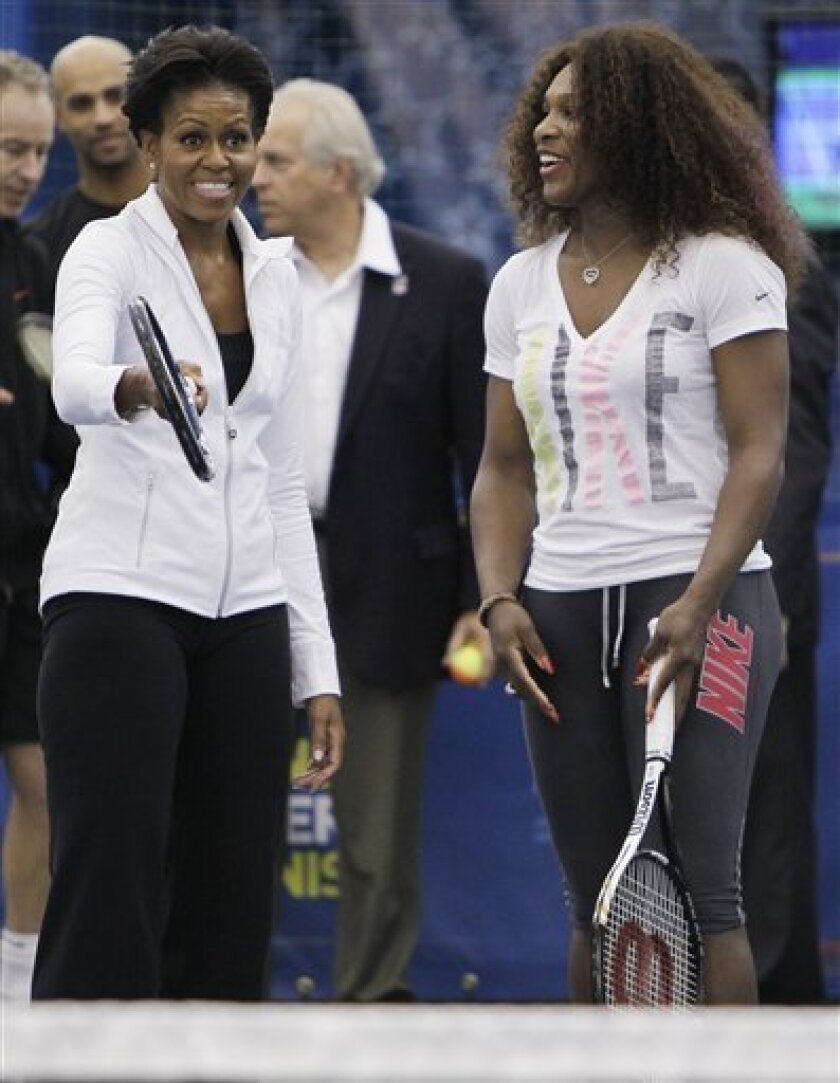 First lady Michelle Obama, left, and Serena Williams talk during a U.S. Open tennis clinic highlighting the importance of physical activity for kids at Billie Jean King National Tennis Center in New York, Friday, Sept. 9, 2011. (AP Photo/Mike Groll)
