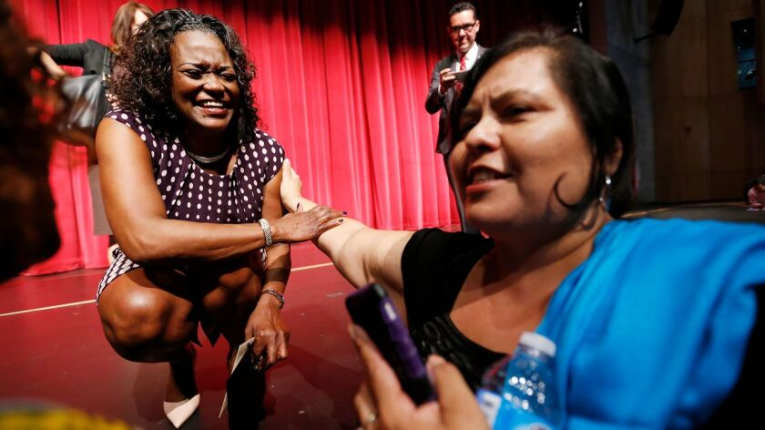 LOS ANGELES, CA - AUGUST 09, 2016 - L.A. Unified Schools Supt. Michelle King, left, is greeted by Sc