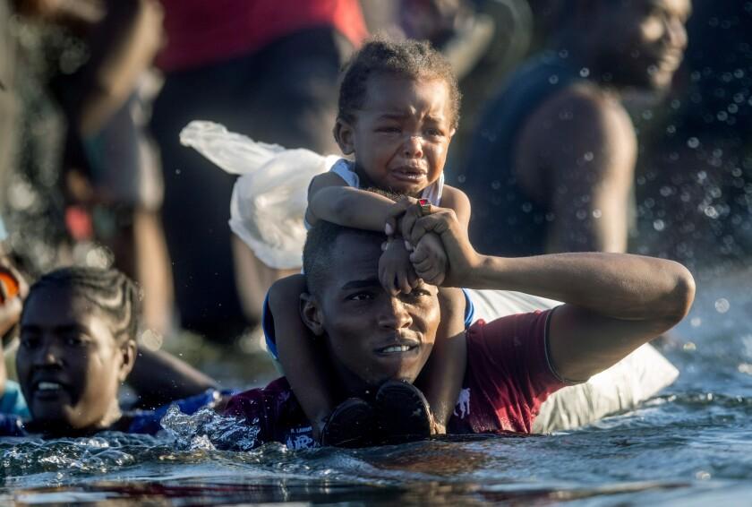 Haitian immigrants cross the Rio Grande from Del Rio, Texas.