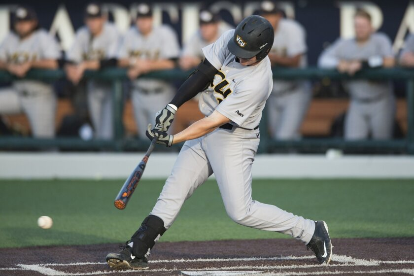 VCU's Brett Hileman hits a two-RBI single during the fourth inning against Dallas Baptist during an NCAA college baseball tournament regional game in Dallas, Friday, May 29, 2015. (AP Photo/Cooper Neill)
