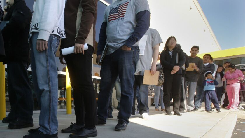 Hundreds of people without legal status line up at the DMV in Stanton, Calif., to apply for driver's licenses on Jan. 2, 2015.