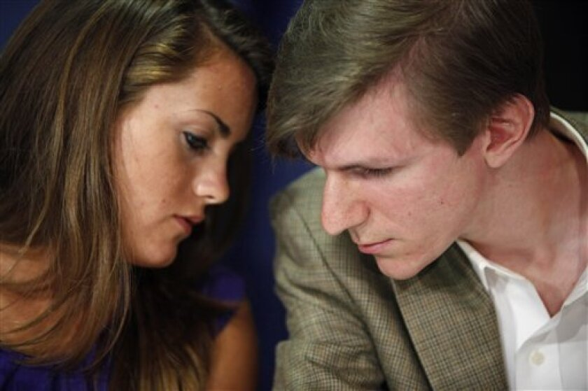 Hannah Giles, left, talks with James O'Keefe III during a news conference, Wednesday, Oct. 21, 2009, at the National Press Club in Washington. (AP Photo/Haraz N. Ghanbari)