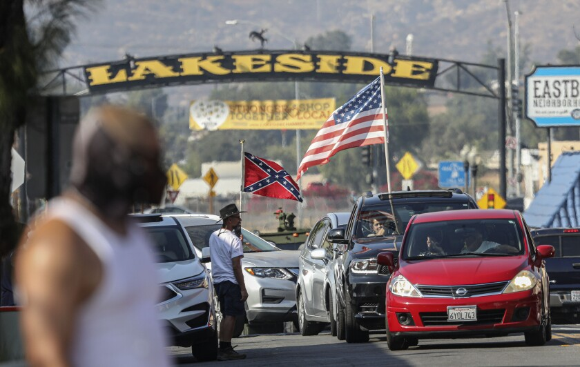Pro Trump supporters heckle BLM activists as they drive in downtown Lakeside during a Caravan for Justice San Diego rally.