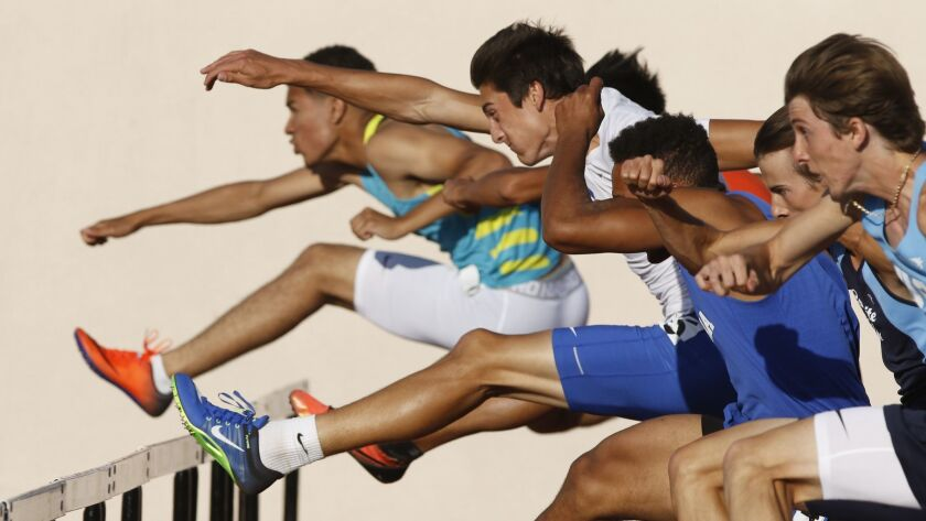 The pack points toward the finish line in the boys 110-meter hurdles Friday at the Escondido Invitational.