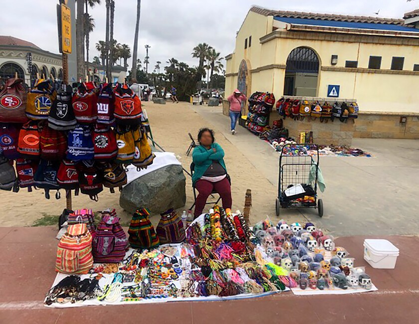 The City is working to create local regulations to incorporate a State law legalizing street vending that came into effect on Jan. 1. Last month, a resident sent this image to <i>PB Monthly</i> to illustrate his frustration with vendors crowding the pathways in Mission Beach.