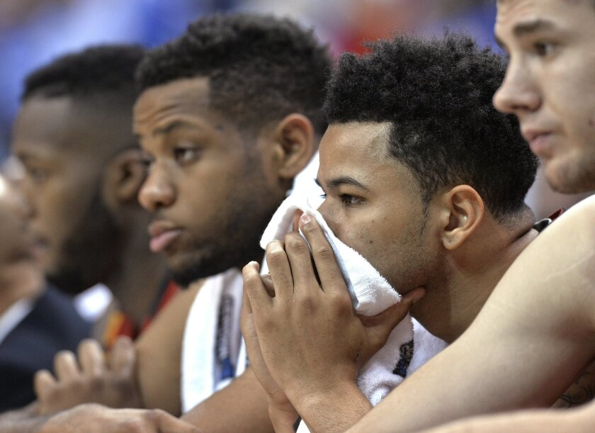 Maryland guard Jaylen Brantley, second from right, sits on the bench late in the second half of the team's 79-63 loss to Kansas in a college basketball game in the regional semifinals of the men's NCAA Tournament, in Louisville, Ky., Thursday, March 24, 2016. (AP Photo/Timothy D. Easley)