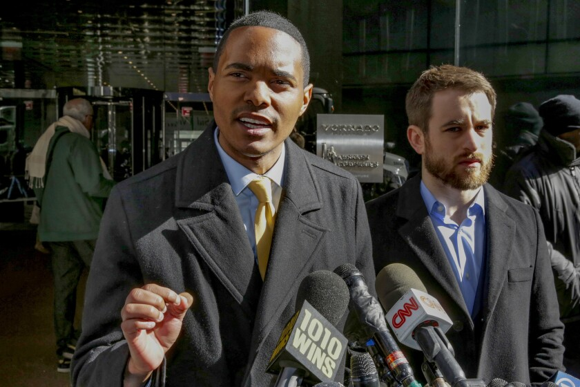 FILE - In this March 19, 2018 file photo, New York City Council Member Ritchie Torres, left, speaks at a news conference outside Kushner Companies headquarters, in New York, along with Housing Rights Initiative Executive Director Aaron Carr. Torres, who will be the first LGBTQ member of Congress from the Bronx if he wins the general election in November, defeated his closest rival for the nomination by more than 8,000 votes in results certified Tuesday, Aug. 4, 2020. (AP Photo/Richard Drew, File)