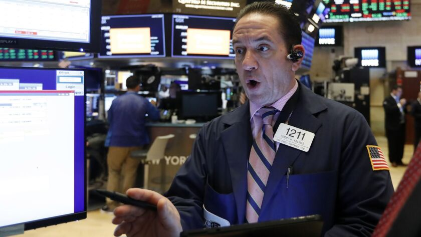 The Dow Jones industrial average climbed 0.7% to 25,720.66 on Thursday. Above, trader Tommy Kalikas at the New York Stock Exchange.