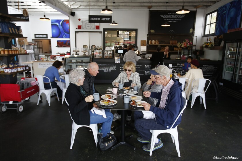 A family of siblings eat at Matteo restaurant in South Park on March 16, 2020. From left to right are, Nancy Abbey, Peter Abbey, Jo Abbey Briggs, Lynne Abbey, and James Abbey.