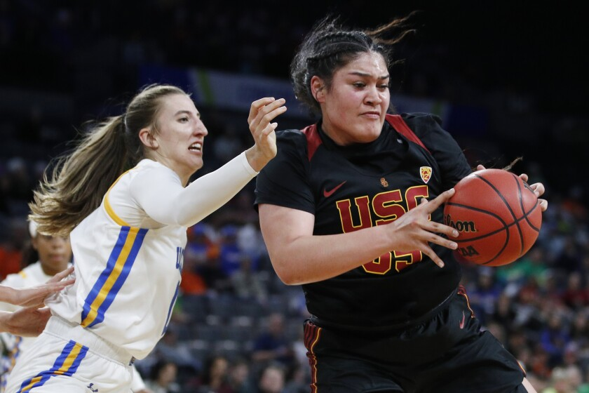 USC's Alissa Pili drives around UCLA's Chantel Horvat during the first half of  quarterfinal game of the Pac-12 women's tournament on March 6 in Las Vegas.