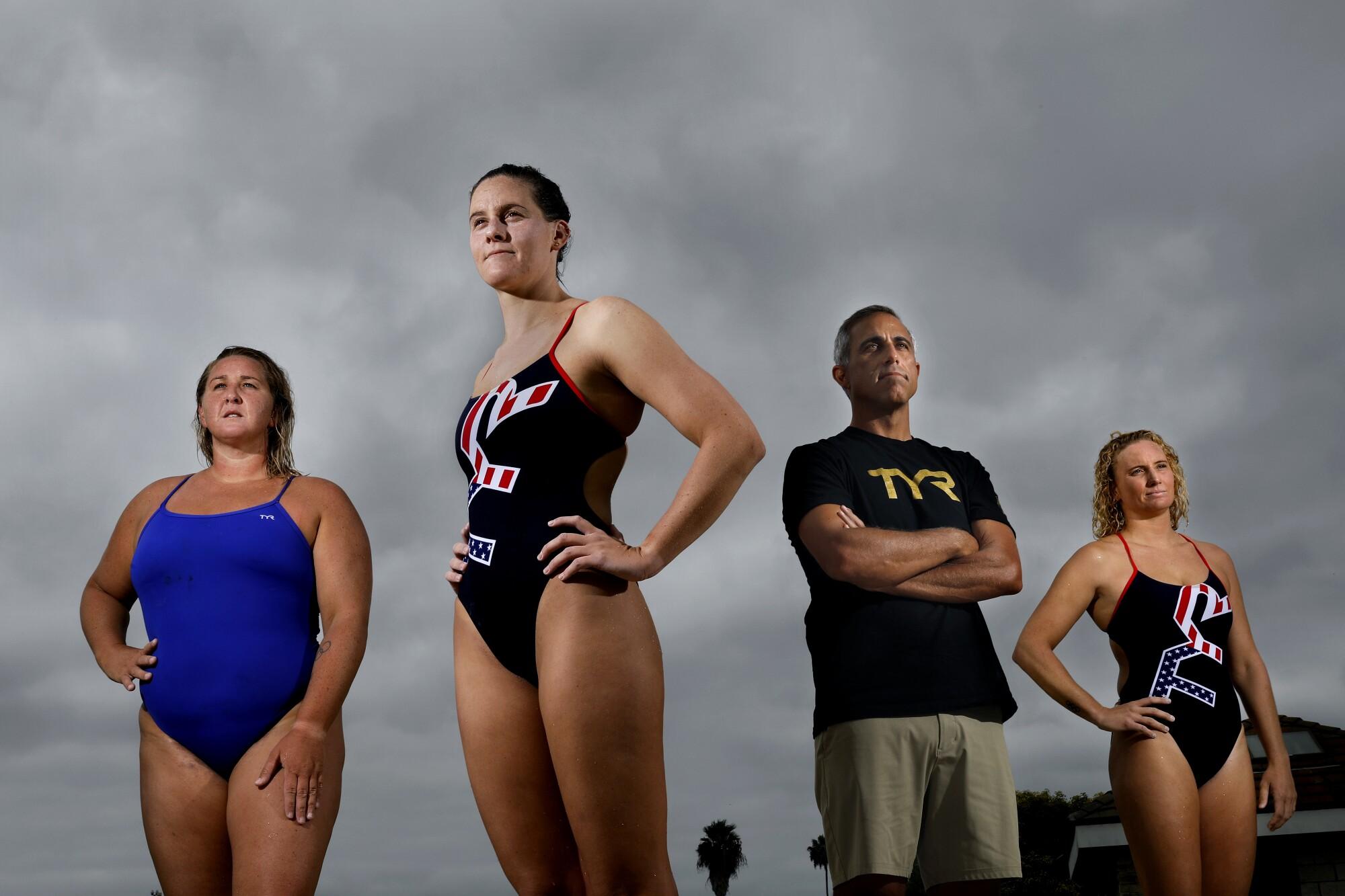 U.S. women's water polo team members Melissa Seidemann, Alys Williams, coach Adam Krikorian and Kaleigh Gilchrist.