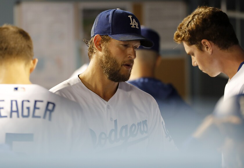 Dodgers starter Clayton Kershaw returns to the dugout.